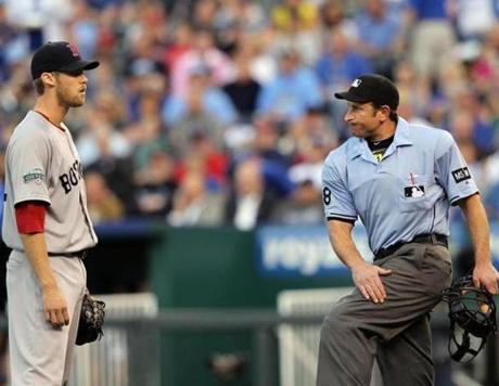 Red Sox starter Daniel Bard is called for the first of two balks by home plate umpire Chris Guccione during the 2nd inning of the game against the Royals.
